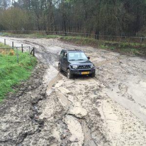 In de modderpoel vast